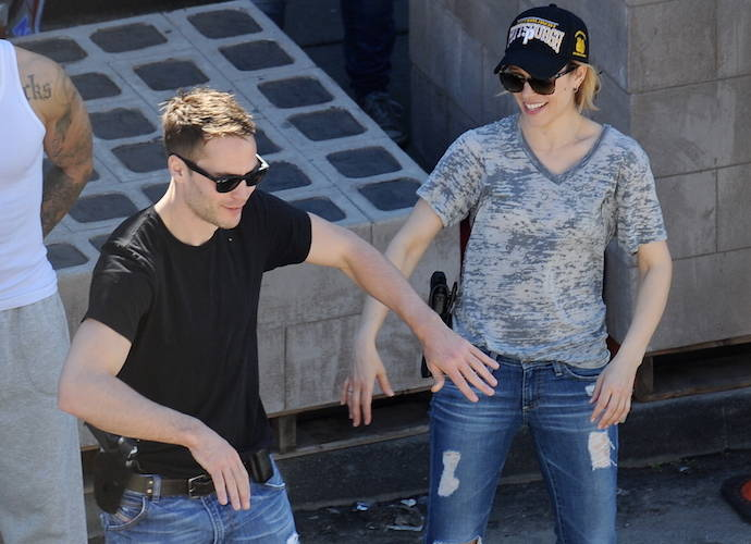 Happier times for couple Rachel McAdams and Taylor Kitsch on the set of True Detective